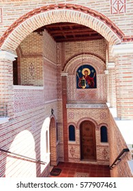 KONDARIOTISSA, PIERIA/GREECE - OCTOBER 6, 2016: Ornated interior of St. Ephrem the Syrian monastery with Our Lady icon on bricklaying wall on October 6, 2016 in Kondariotissa.