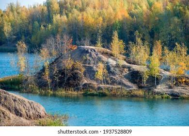 Konduki, Tula region, Romancevskie mountains, Abandoned Ushakov quarries. Turquoise water lakes and the mud erosion of the soil looks like mountains. Beautiful natural landscape