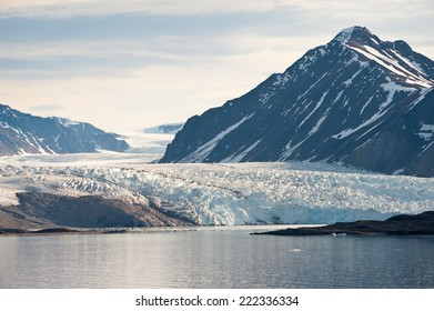 The Kongsbreen glacier, Spitsbergen, seen across the Kongsfjordan in early morning light during twenty four hour daylight.