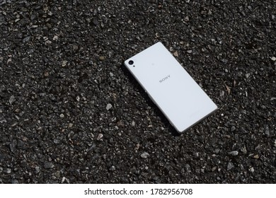 Kongsvinger, Norway 24 July 2020: White Android Smartphone with Sony sign isolated technology Digital network device product screen down 24 megapixels camera lens