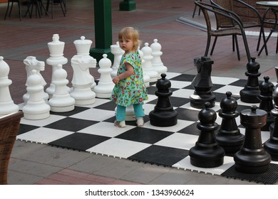 Kongsvinger, Norway July 21, 2012. A child in a big chess game in Kongsvinger.