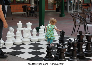 Kongsvinger, Norway July 21, 2012. A child walking in a big chess game in Kongsvinger.