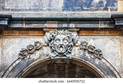 KONIGSTEIN, SAXONY, GERMANY - OCTOBER 2, 2019: Capstone of the Konigstein Fortress entrance gateway sculpted with a daunting face of a man.
