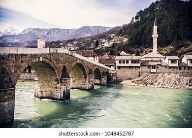 KONJIC, BOSNIA AND HERZEGOVINA - March 2018: View of old stone bridge across river Neretva in Konjic, Bosnia and Herzegovina