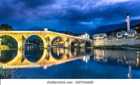 Konjic Bosnia and Herzegovina old town bridge at night, neretva river and mosque.