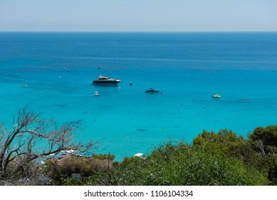 KONNOS BAY, CYPRUS - JUNE 15, 2017: Yacht setting anchor in Konnos bay beach, Protaras. People bathing in the lagoon