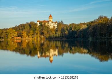 Konpiste castle reflected in the lake; odraz zámku Konopiště  v hladině rybníka; blue sky above castle  - Shutterstock ID 1613188276