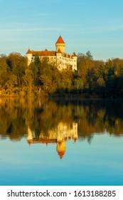 Konpiste castle reflected in the lake; odraz zámku Konopiště  v hladině rybníka; blue sky above castle  - Shutterstock ID 1613188285