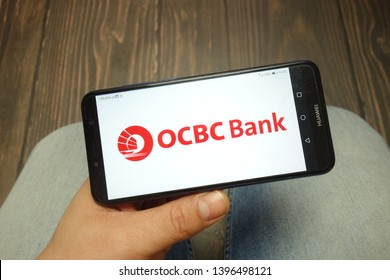 KONSKIE, POLAND - 05 MAY, 2019: OCBC Bank logo displayed on Huawei smartphone