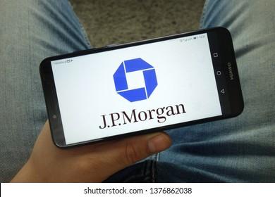 KONSKIE, POLAND - April 13, 2019: Man holding smartphone with JP Morgan  Chase & Co. logo