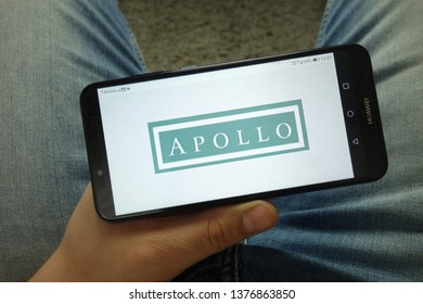 KONSKIE, POLAND - April 13, 2019: Man holding smartphone with Apollo Global  Management, LLC logo