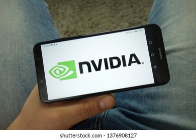KONSKIE, POLAND - April 13, 2019: Man holding smartphone with Nvidia  Corporation logo
