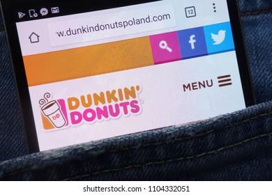 KONSKIE, POLAND - JUNE 01, 2018: Dunkin Donuts website displayed on smartphone hidden in jeans pocket
