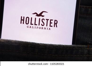 KONSKIE, POLAND - JUNE 02, 2018: Hollister logo displayed on smartphone hidden in jeans pocket