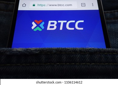 KONSKIE, POLAND - JUNE 02, 2018: BTCC cryptocurrency exchange website displayed on smartphone hidden in jeans pocket