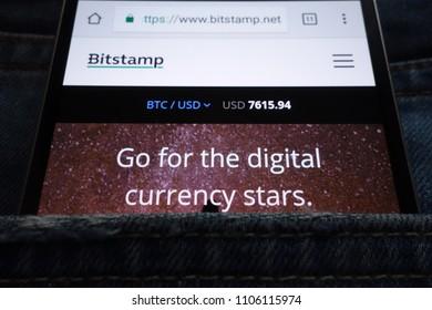 KONSKIE, POLAND - JUNE 02, 2018: Bitstamp cryptocurrency exchange website displayed on smartphone hidden in jeans pocket