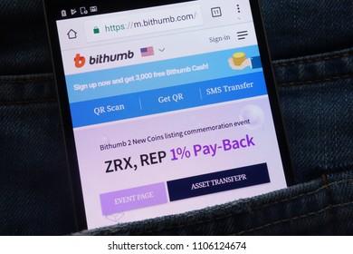 KONSKIE, POLAND - JUNE 02, 2018: Bithumb cryptocurrency exchange website displayed on smartphone hidden in jeans pocket