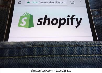 KONSKIE, POLAND - JUNE 02, 2018: Shopify website displayed on smartphone hidden in jeans pocket