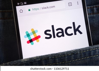 KONSKIE, POLAND - JUNE 02, 2018: Slack website displayed on smartphone hidden in jeans pocket