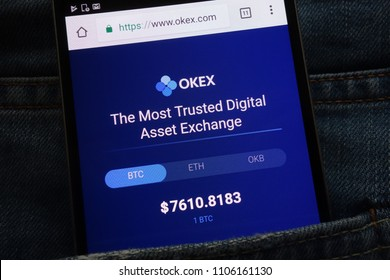 KONSKIE, POLAND - JUNE 02, 2018: OKEX cryptocurrency exchange website displayed on smartphone hidden in jeans pocket