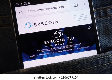 KONSKIE, POLAND - JUNE 02, 2018: Syscoin cryptocurrency website displayed on smartphone hidden in jeans pocket