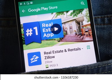 KONSKIE, POLAND - JUNE 02, 2018: Zillow Real Estate app on Google Play Store website displayed on smartphone hidden in jeans pocket