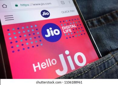 KONSKIE, POLAND - JUNE 02, 2018: Jio website displayed on smartphone hidden in jeans pocket