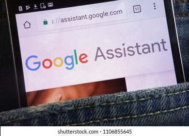 KONSKIE, POLAND - JUNE 02, 2018: Google Assistant website displayed on smartphone hidden in jeans pocket