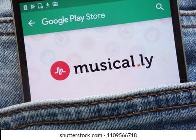 KONSKIE, POLAND - JUNE 09, 2018: Musical.ly app on Google Play Store website displayed on smartphone hidden in jeans pocket