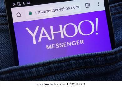 KONSKIE, POLAND - JUNE 11, 2018: Yahoo Messenger website displayed on smartphone hidden in jeans pocket
