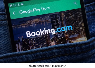 KONSKIE, POLAND - JUNE 11, 2018: Booking.com app on Google Play Store website displayed on smartphone hidden in jeans pocket