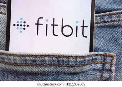KONSKIE, POLAND - JUNE 12, 2018: Fitbit logo displayed on smartphone hidden in jeans pocket
