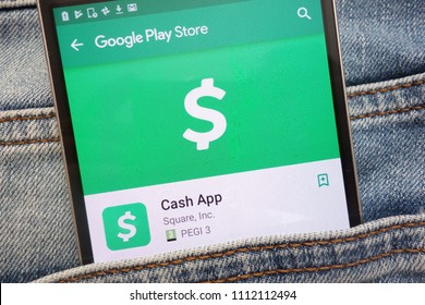 KONSKIE, POLAND - JUNE 12, 2018: Cash App on Google Play Store website displayed on smartphone hidden in jeans pocket