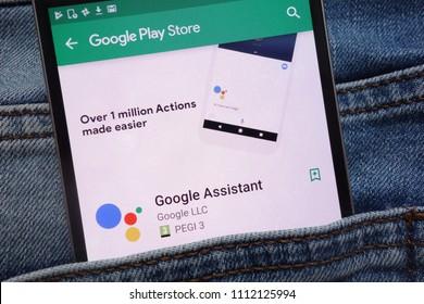 KONSKIE, POLAND - JUNE 12, 2018: Google Assistant app on Google Play Store website displayed on smartphone hidden in jeans pocket