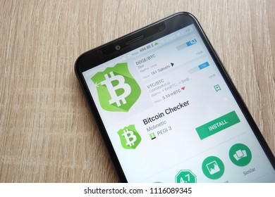 KONSKIE, POLAND - JUNE 17, 2018: Bitcoin Checker app on Google Play Store website displayed on Huawei Y6 2018 smartphone