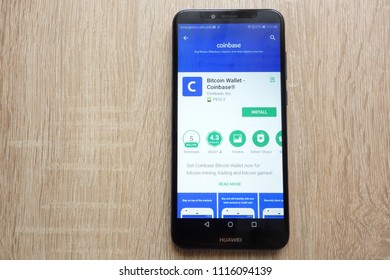KONSKIE, POLAND - JUNE 17, 2018: Coinbase Bitcoin Wallet app on Google Play Store website displayed on Huawei Y6 2018 smartphone