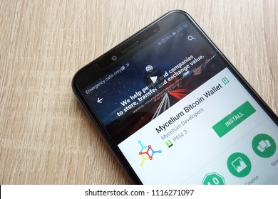 KONSKIE, POLAND - JUNE 17, 2018: Mycelium Bitcoin Wallet app on Google Play Store website displayed on Huawei Y6 2018 smartphone