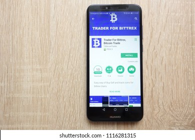 KONSKIE, POLAND - JUNE 17, 2018: Trader For Bittrex, Bitcoin Trade app on Google Play Store website displayed on  Huawei Y6 2018 smartphone