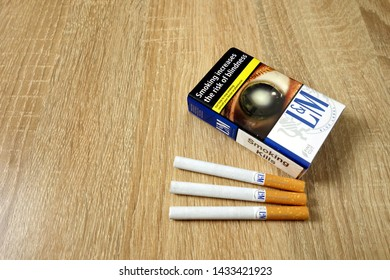 KONSKIE, POLAND - June 21, 2019: Blue LM pack of cigarettes on wooden table background