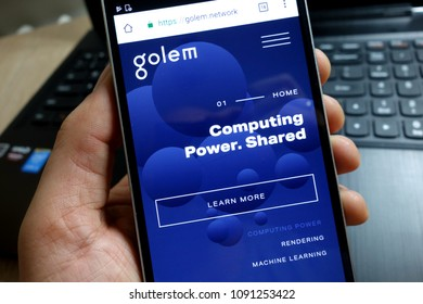 KONSKIE, POLAND - MAY 07, 2018: Smartphone with Golem crypto currency homepage golem.network displayed