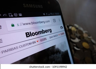 KONSKIE, POLAND - MAY 14, 2018: Bloomberg website displayed on Samsung smartphone and stack of coins
