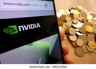 KONSKIE, POLAND - MAY 14, 2018: Nvidia website displayed on smartphone and stack of coins