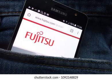 KONSKIE, POLAND - MAY 16, 2018: Fujitsu website displayed on Samsung smartphone hidden in jeans pocket
