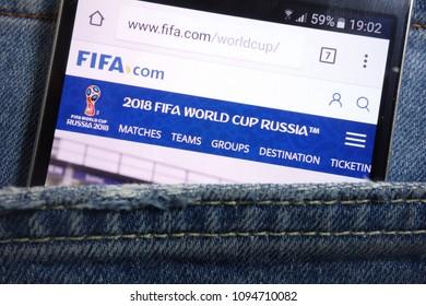 KONSKIE, POLAND - MAY 17, 2018: Fifa website displayed on smartphone hidden in jeans pocket