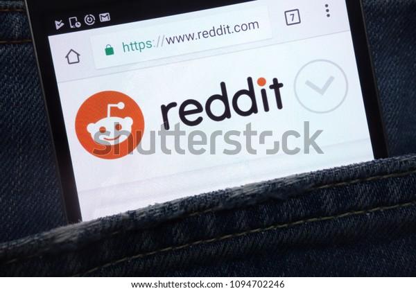 KONSKIE, POLAND - MAY 17, 2018: Reddit website displayed on smartphone hidden in jeans pocket