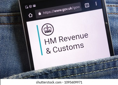 KONSKIE, POLAND - MAY 18, 2018: The UK government website for HM Revenue and Customs displayed on smartphone hidden in jeans pocket