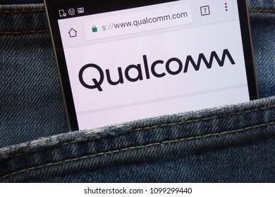 KONSKIE, POLAND - MAY 19, 2018: Qualcomm website displayed on smartphone hidden in jeans pocket