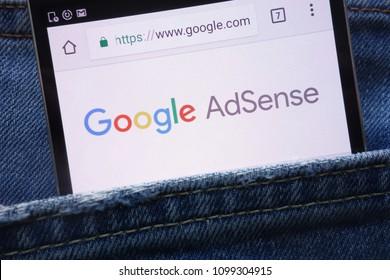 KONSKIE, POLAND - MAY 19, 2018: Google AdSense website displayed on smartphone hidden in jeans pocket