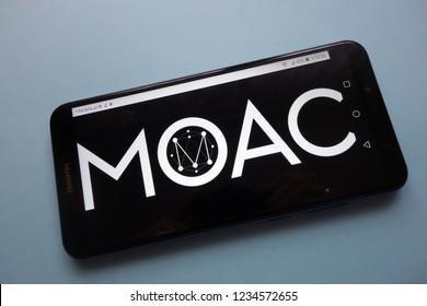 KONSKIE, POLAND - November 18, 2018: MOAC cryptocurrency logo  displayed on smartphone