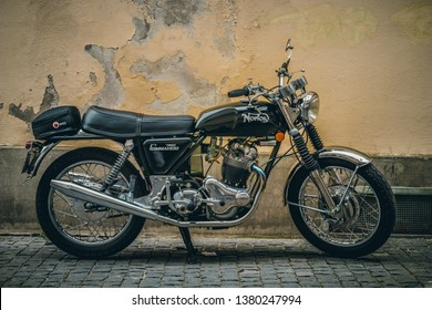 Konstanz, Germany - April 21, 2019: Norton Commando 750 motorcycle standing by an old rugged wall.